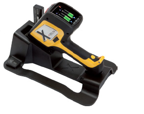 DELTA Handheld XRF Analyzer on charging dock.